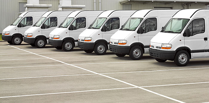 Motor Fleet Insurance: A row of six white vans.